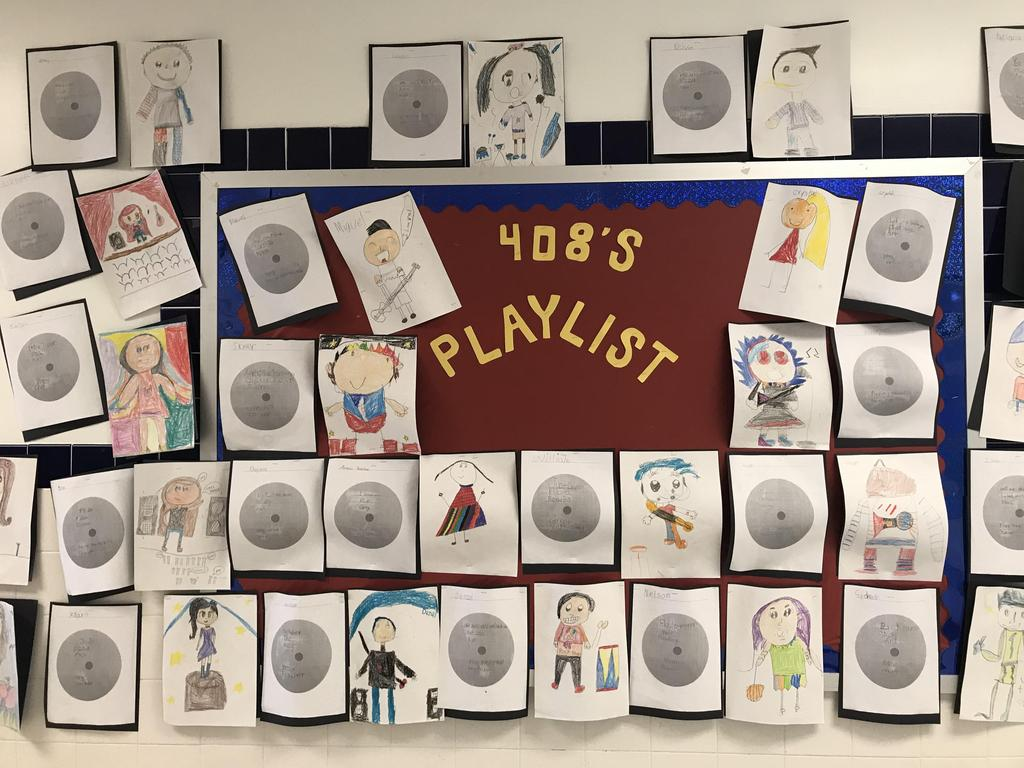bulletin board display: 408's Playlist students self portraits