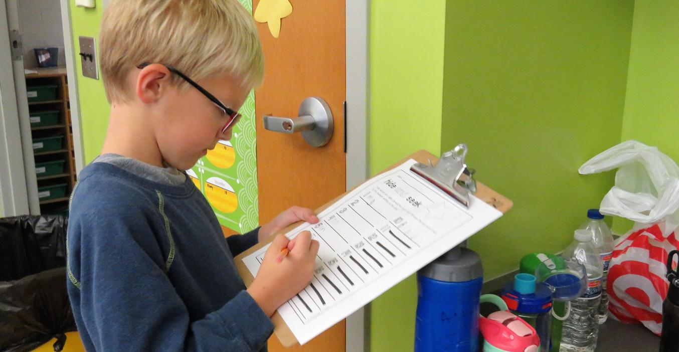 A classroom word scavenger hunt helps students learn sight words.