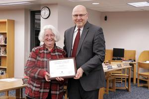 Wendy Stafford and Supt. Jeff Haase as he presents her with a plaque and certificate.