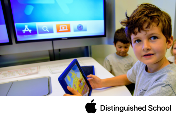 Primary student using iPad for learning.
