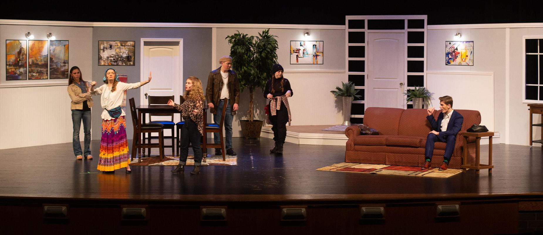 cast of six high school students acts out You Can't Beat the House play on stage