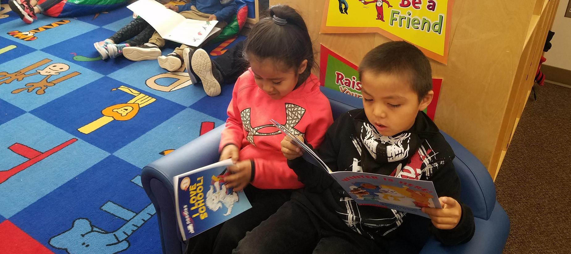 Two students reading books