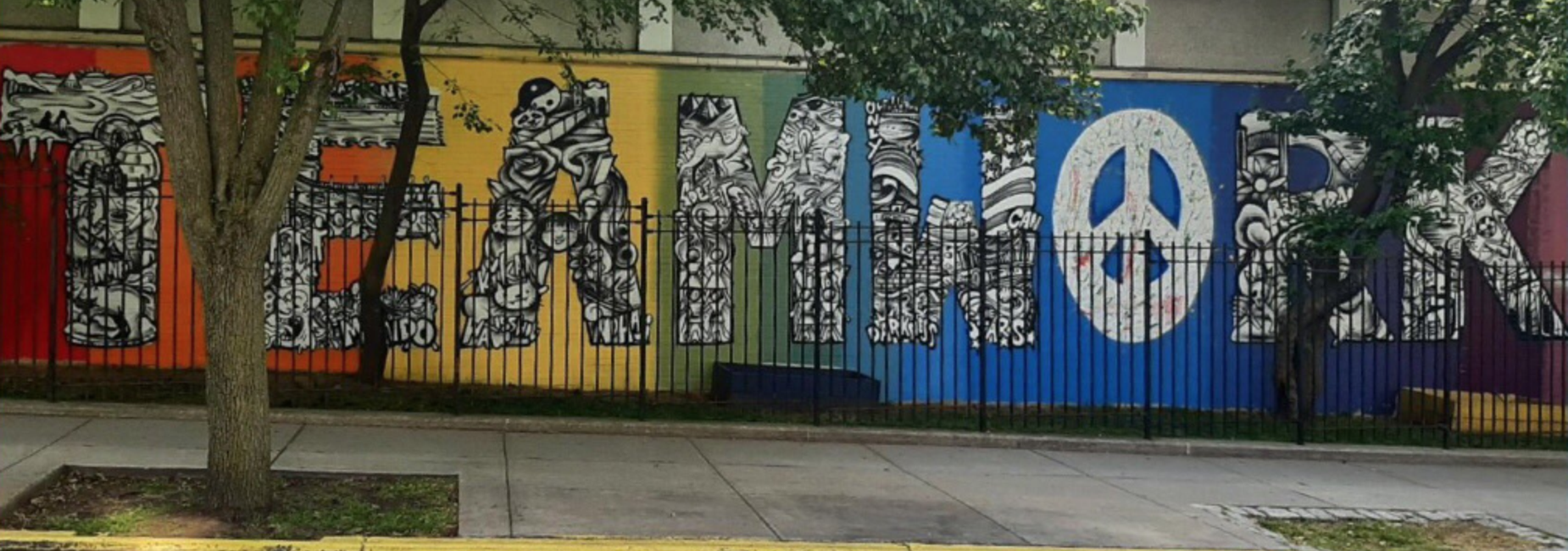 Rainbow Colored Teamwork mural outside of P.S. 16 painted on the wall.