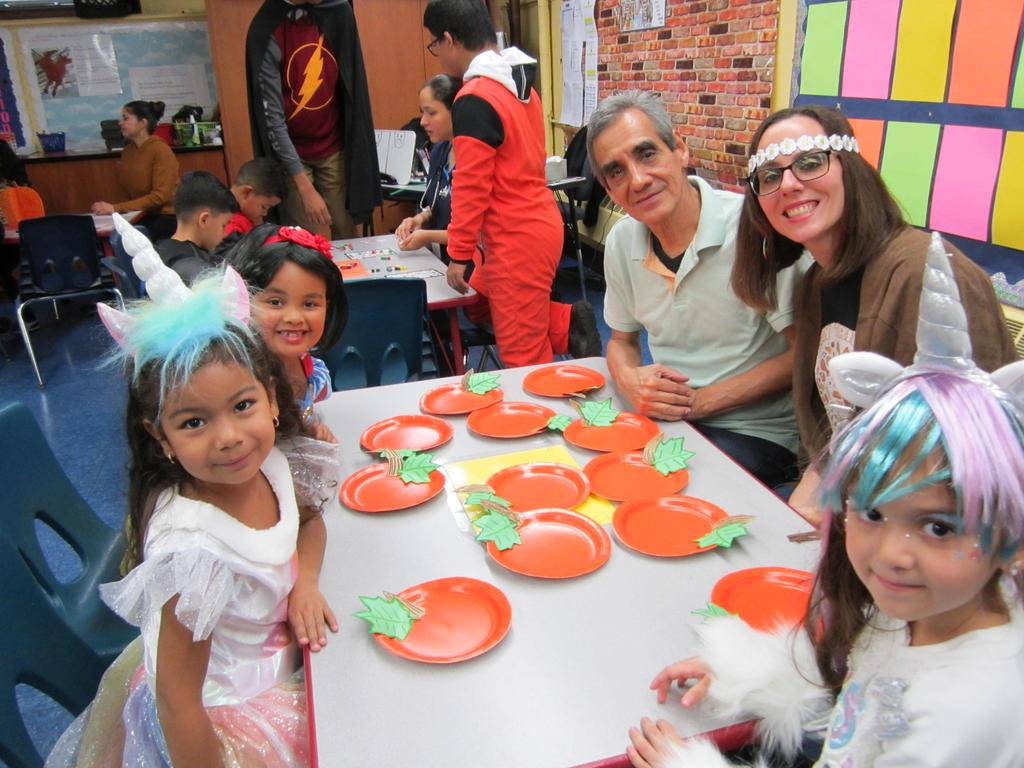 Ms. Viera, an male aide and three little girls dressed as snow white and unicorns