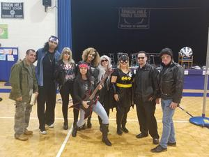 UHMS Admin dressed as rockers and super heros