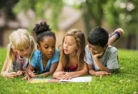 Students reading in the grass
