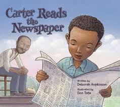 African American boy reading a newspaper