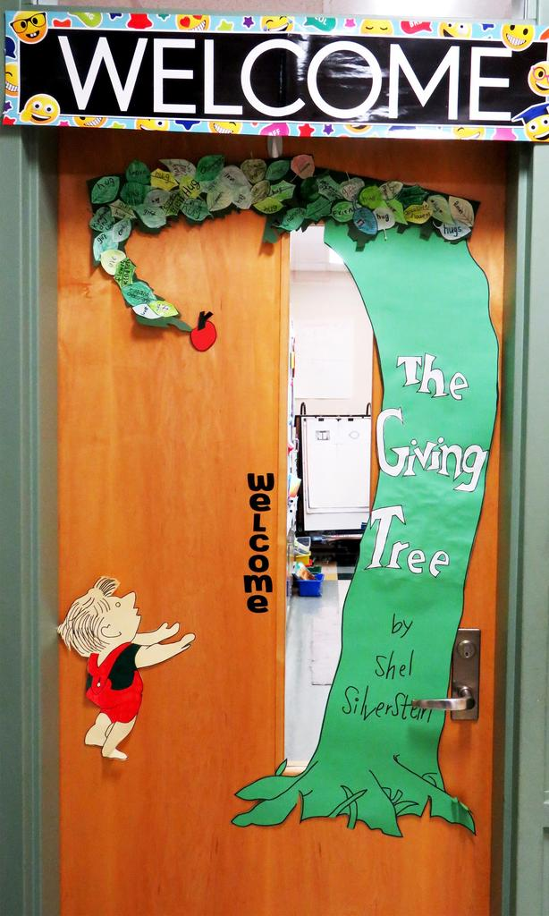 """A door decorated with """"The Giving Tree"""""""