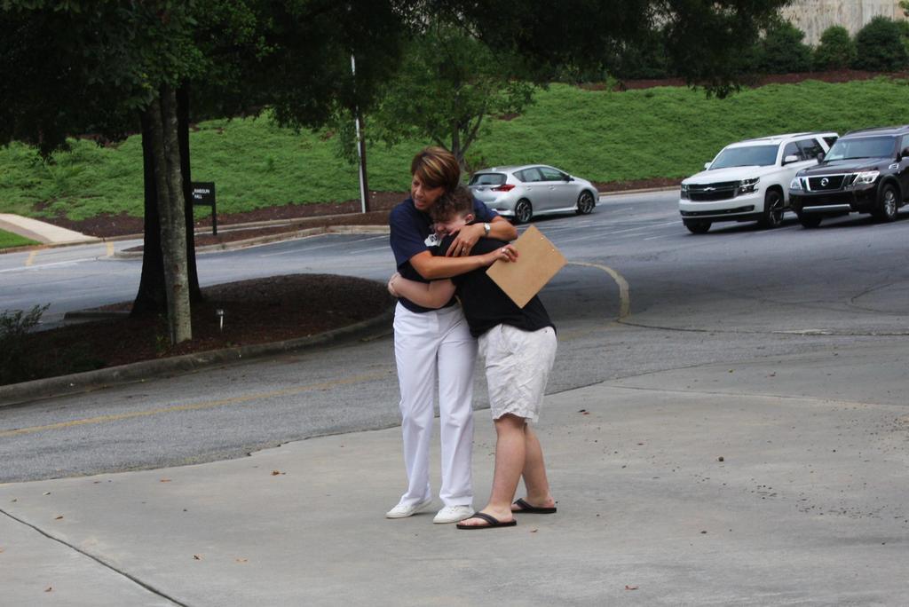 Principal, Michelle Shepherd, hugs student on the first day of school at WECHS