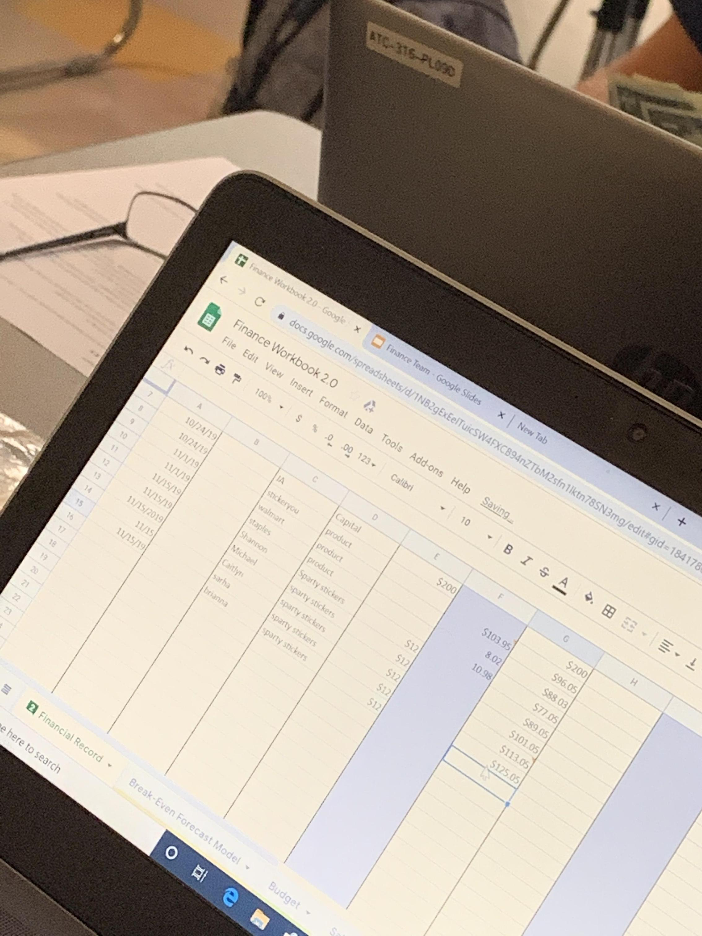 Excel sheet open on computer in Business class