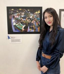 Elaine Gong poses with her artwork, Vegetarian's Perspective