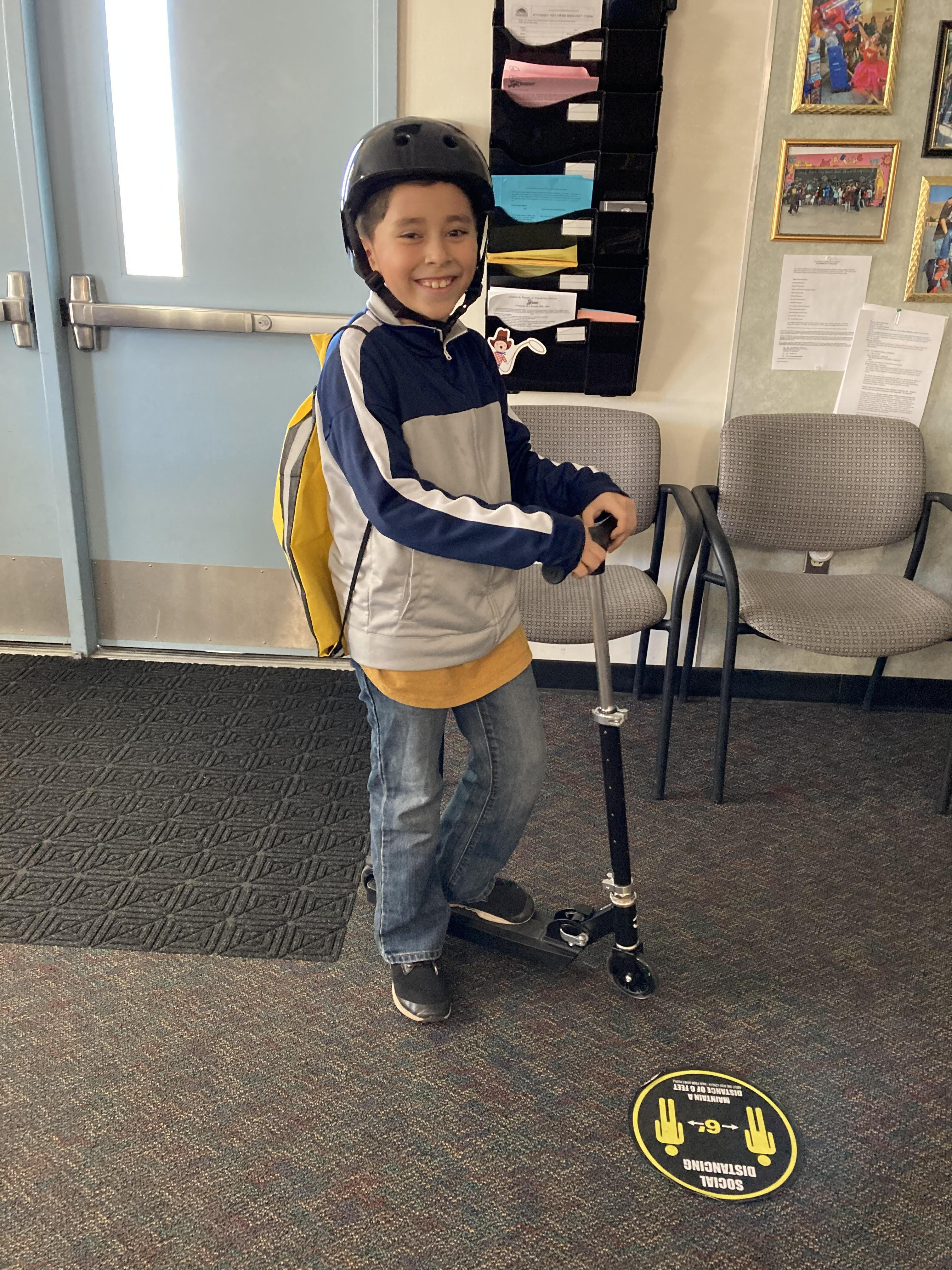 Jovanny Sanchez, Grade 4 - Mr. Dabney's Class - Light Up Scooter and helmet