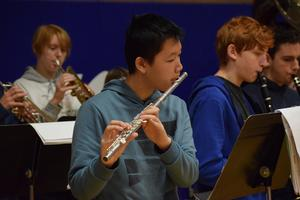 teens playing band instruments