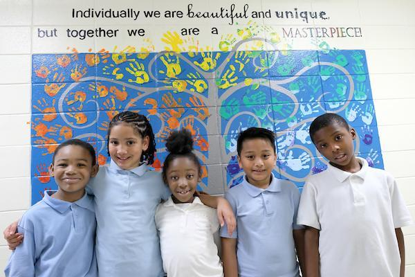Students in front of school mural