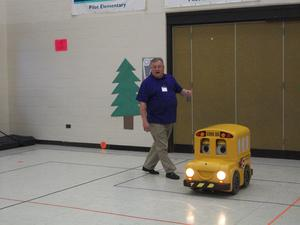 Buster the Bus and his friend in the gym.