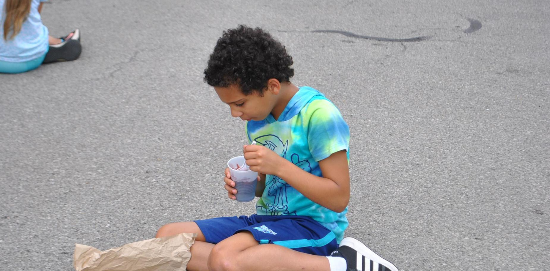 student eating a snow cone