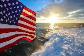 photo of U.S. flag on a beach