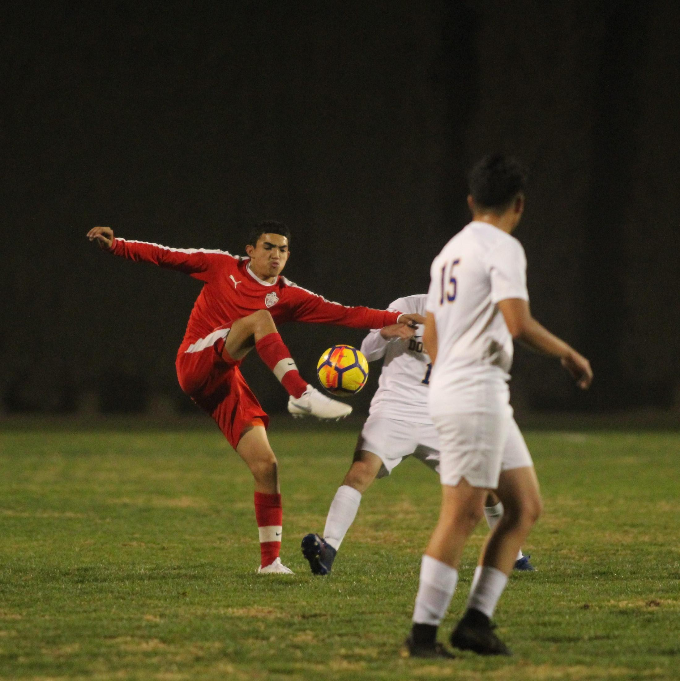 Edgar Campos kicking the ball