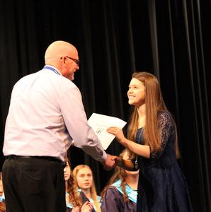 Gananda High School Principal Mahoney hands out NHS Certificates to newest inductees.