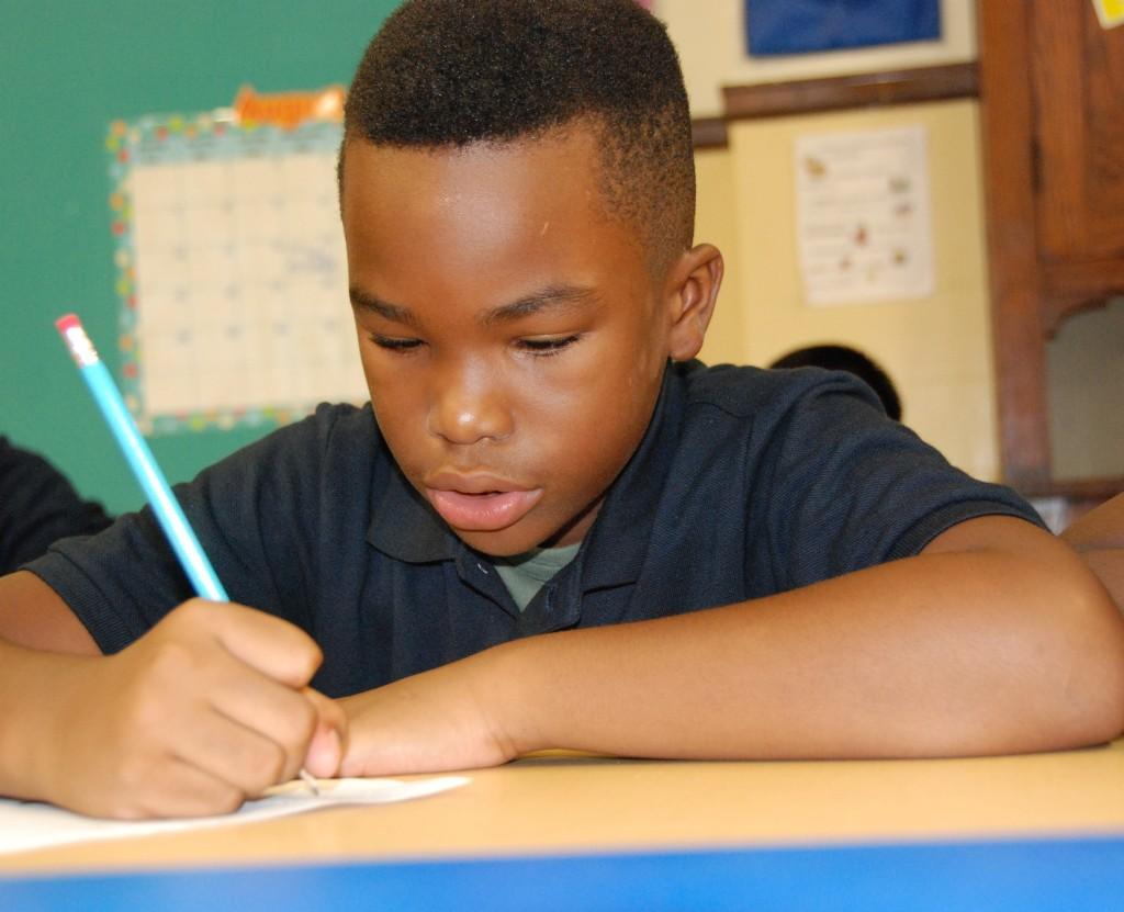 Boy writing, first day of school 2016-17