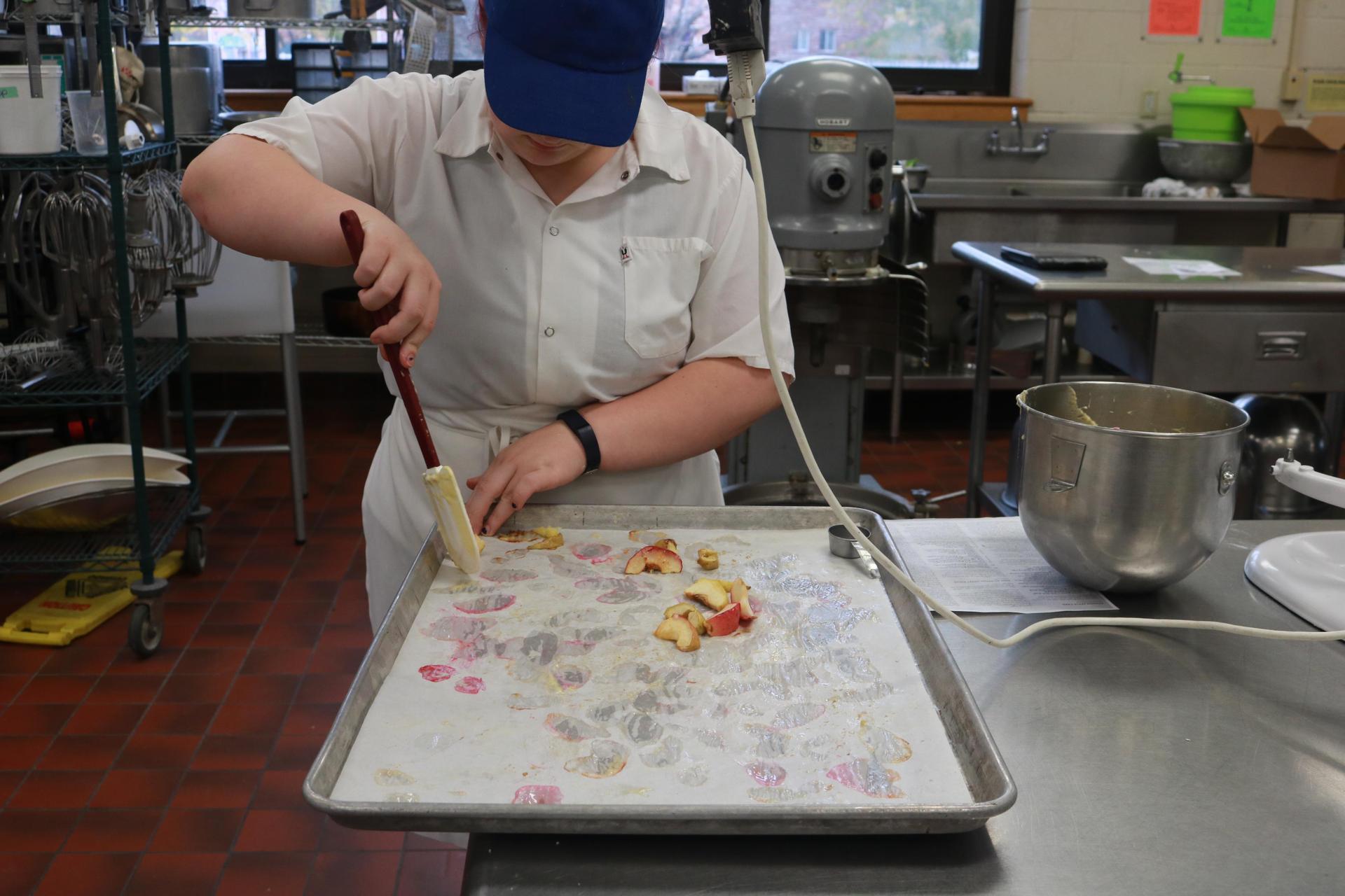 Student working on food preparation