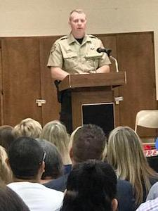 Deputy Cook addresses the students and parents.