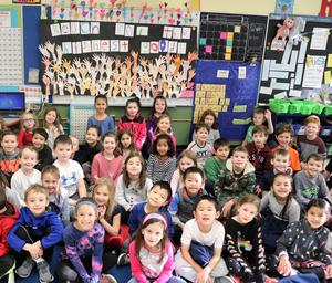 "First graders at Tamaques School in Westfield honored Dr. Martin Luther King, Jr by reciting a portion of his ""I Have a Dream"" speech and discussing the meaning of Dr. King's legendary oration at the March on Washington in August 1963.  ""It's like living your inside out,"" said one youngster when asked about a part of the speech where the civil rights leader said ""I have a dream that my four little children will one day live in a nation where they will not be judged by the color of their skin, but by the content of their character.""  Led by the 1st grade team of Linda D'Onofrio, Mary Montes, and Jenna Utman, the students also created a mural poster entitled ""Reach for the Highest Good."""