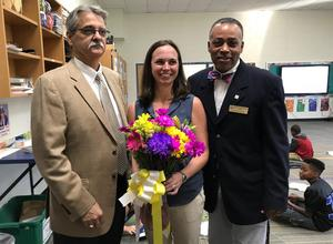 Lexington Two Superintendent Dr. William James Jr., left, Principal Leonard Frierson, right, with District Teacher of the Year Kim Donovan