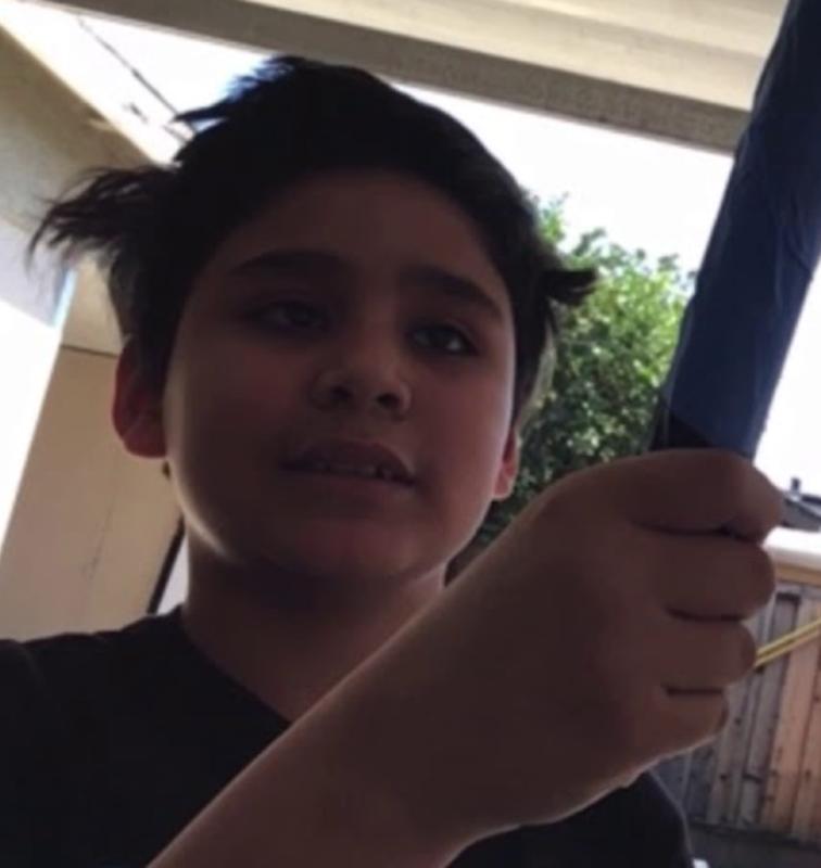 student shows light saber