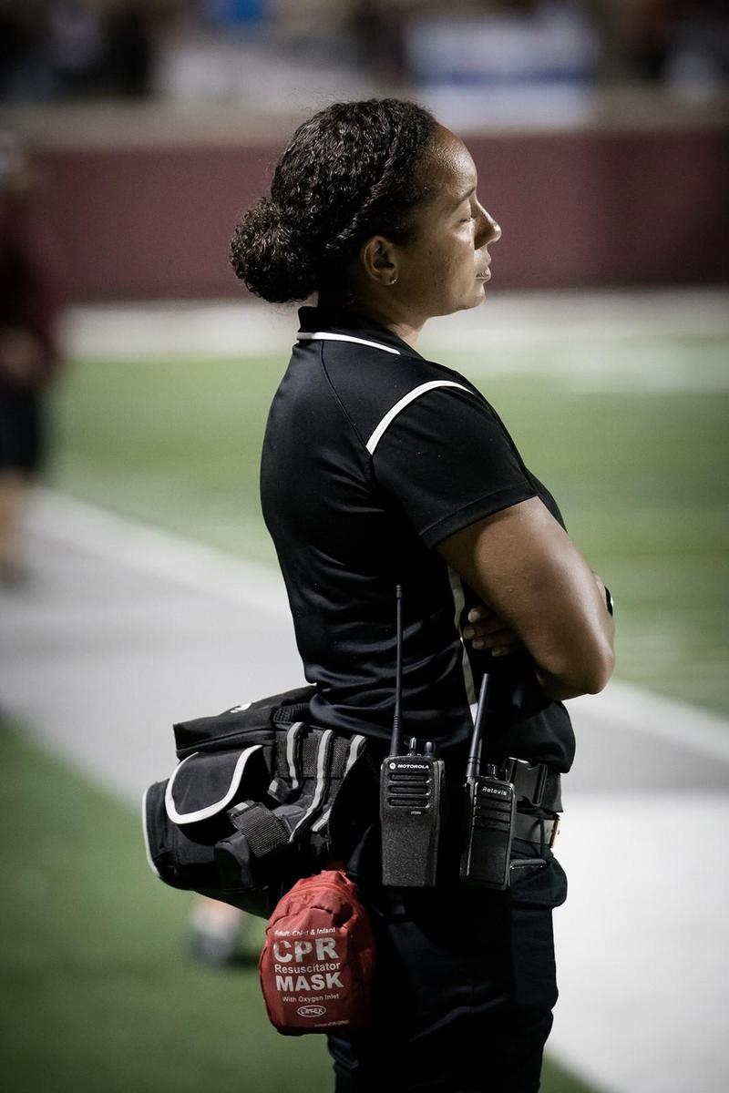Keasha Russell watching the football game on the sidelines