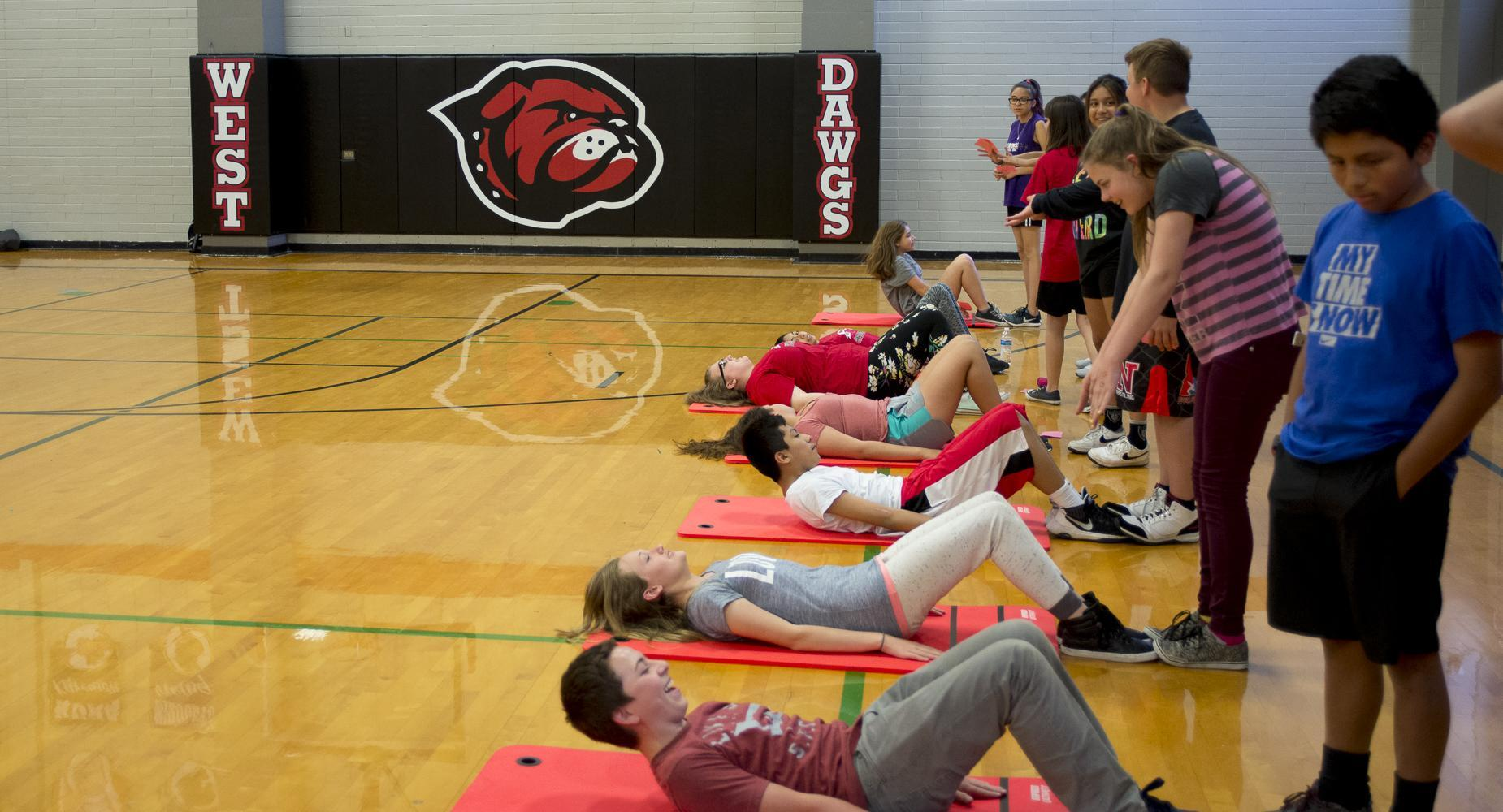 Students do situps in PE