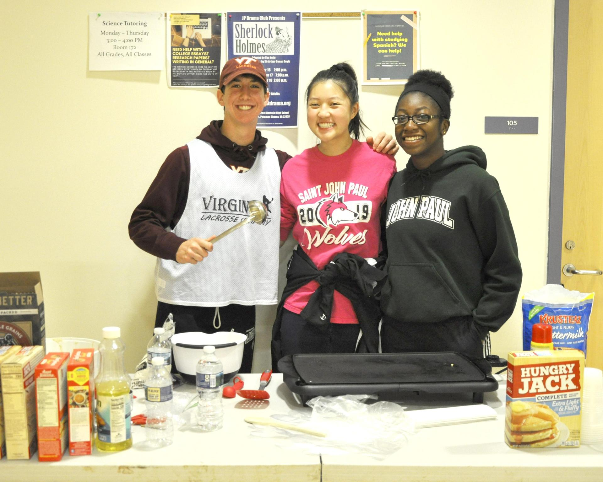 A group of students cooking breakfast before the JP5k