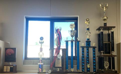 Row of Academic Decathlon Trophies