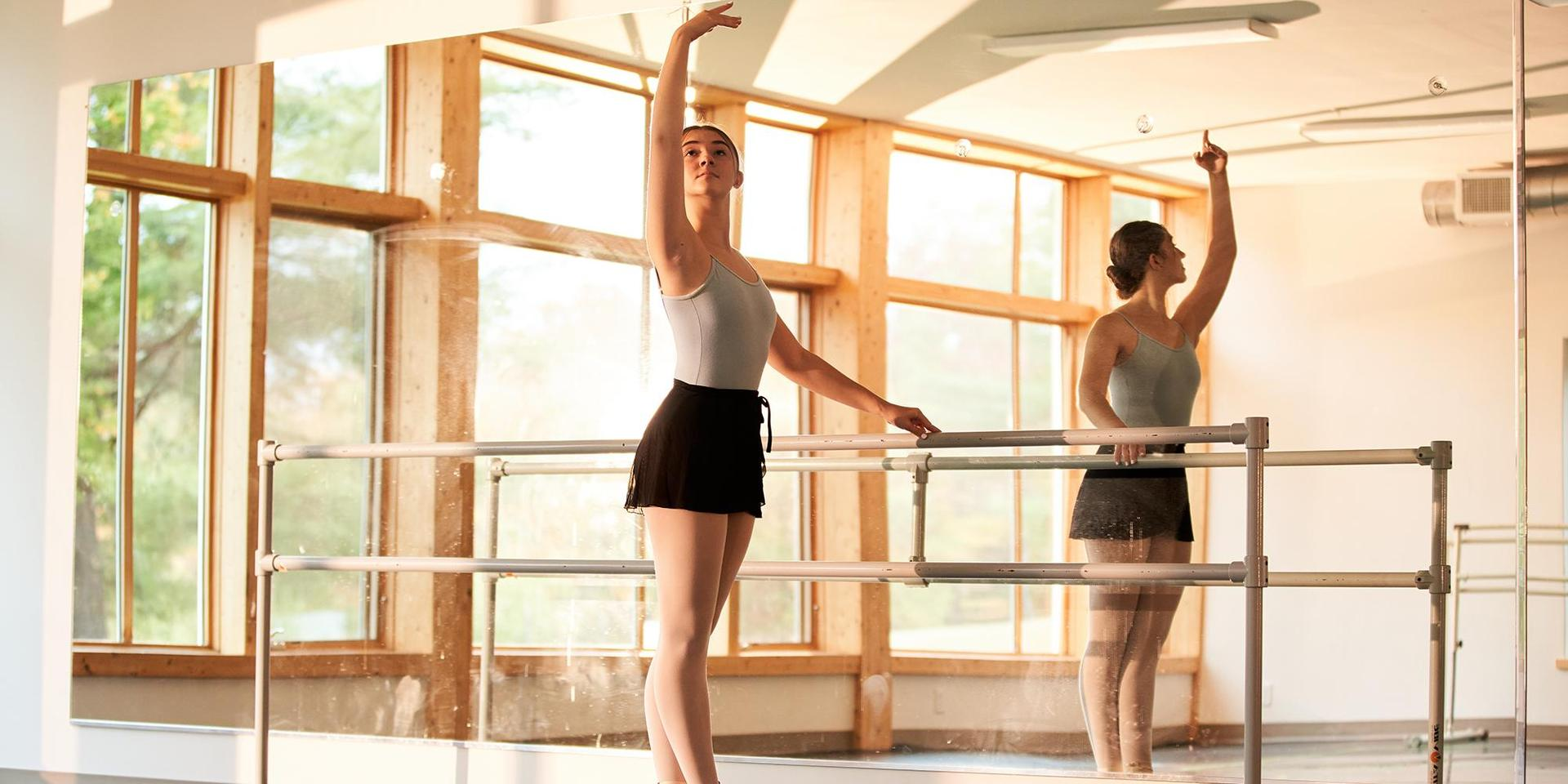 A student practicing in front of the mirrors in Studio A.