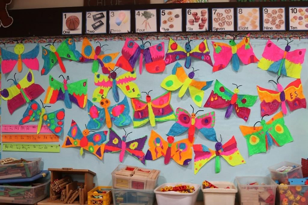 Butterflies created by students on the wall of a classroom