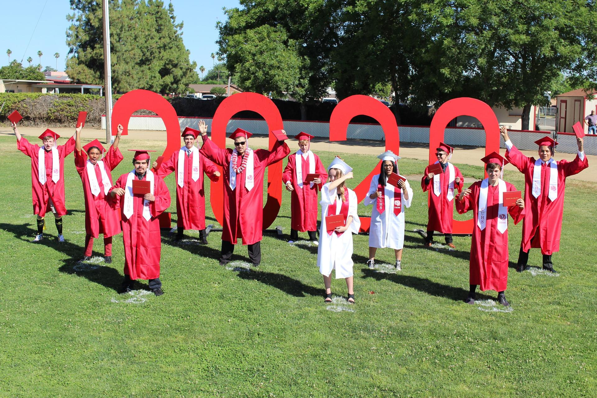 Left to right, Blake Kazynski, Lawrence Luna, Roy Martinez, Jared Guerrero, Vincent Velasquez, Cody Harrell, Zoe Rasmussen, Frances Ceja, Alfredo Luna, Andrew Castaneda, and Lyzander Campos turning their tassels