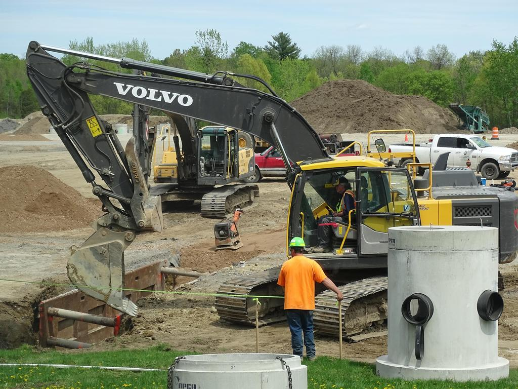 This snapshot during May 2019 illustrates the coordinated use of heavy construction equipment by experienced operators employed by site contractor J E Sheehan.