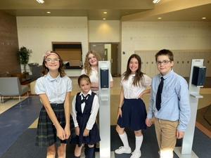 Legacy Preparatory Academy best charter school in davis county kids in entry way of school
