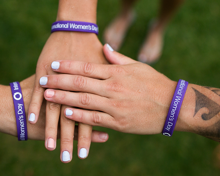 Image from International Women's Day of arms together with bracelets