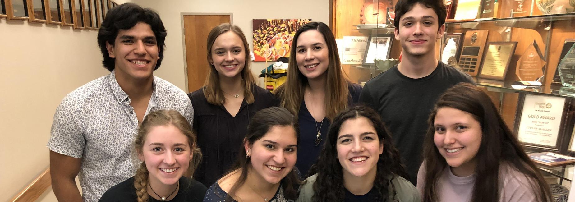 student council members and sponsor posing