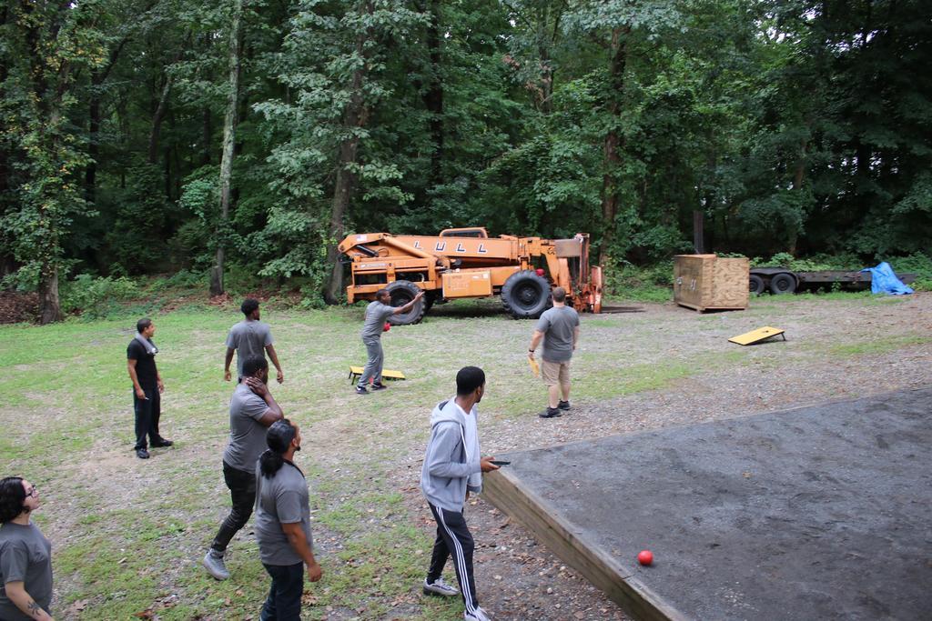 Staff enjoying DSP Week playing cornhole