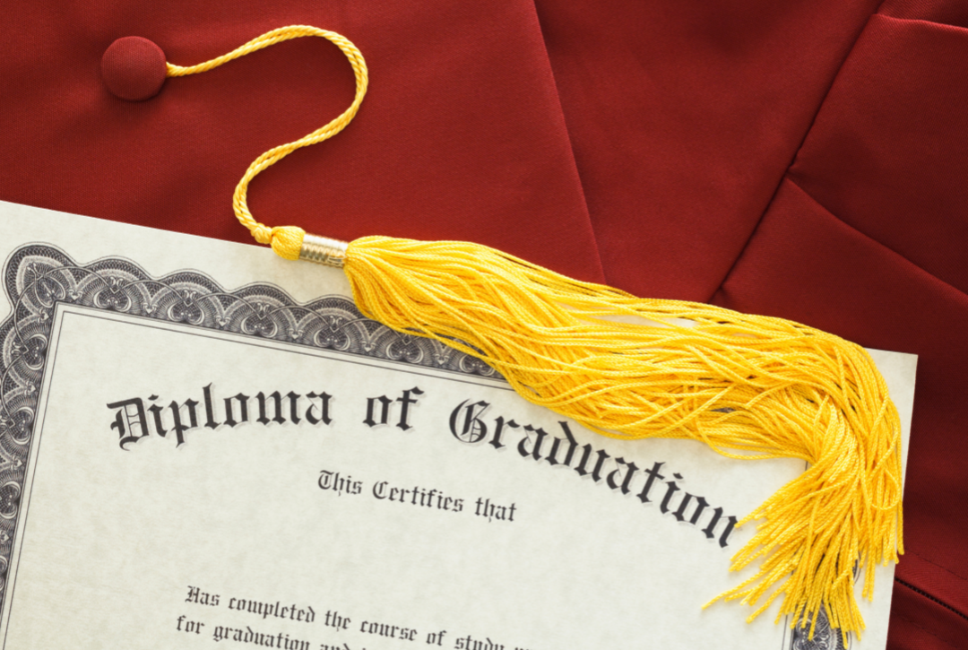 maroon cap and gown and diploma