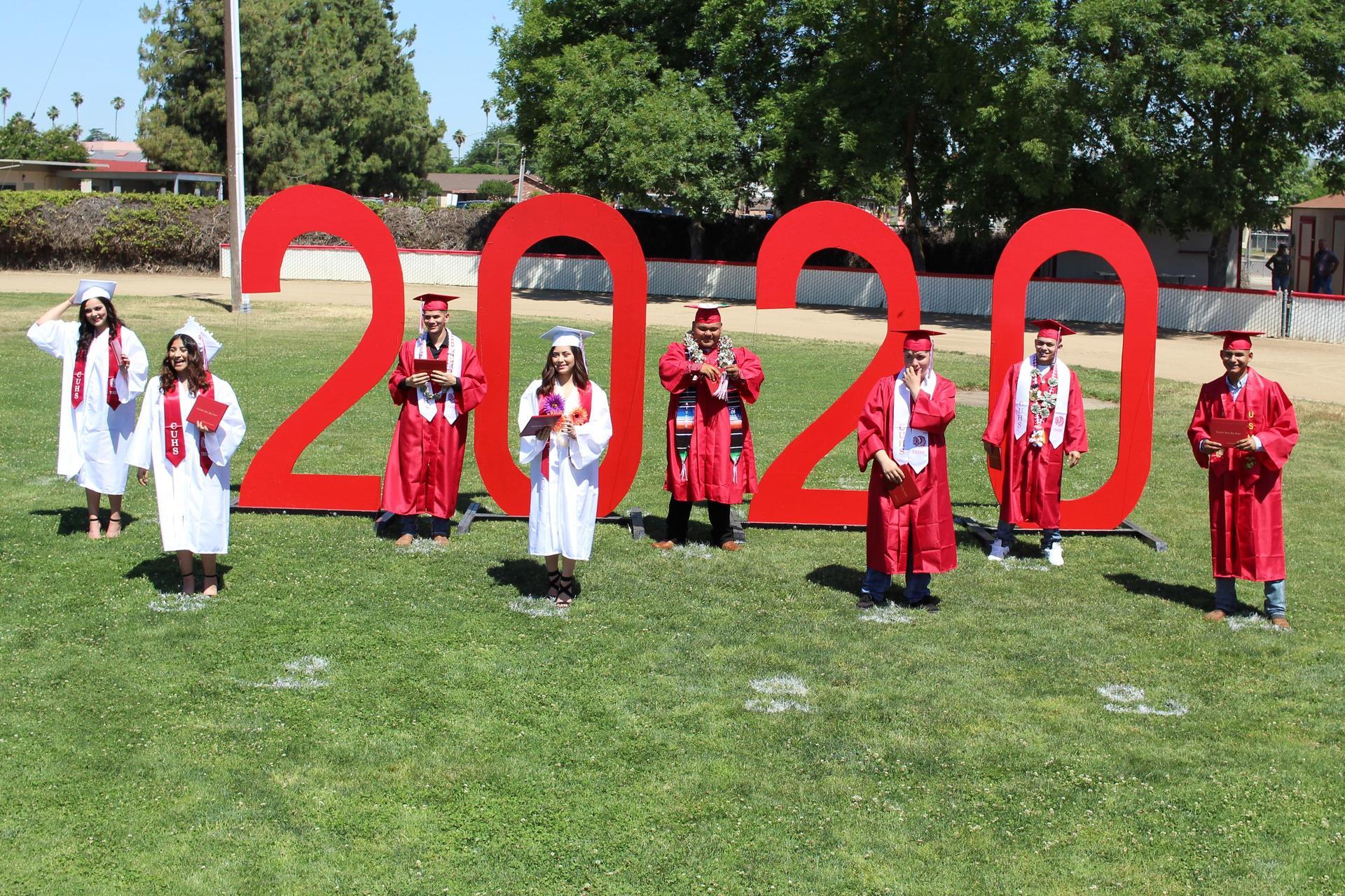 Left to right, Juliana Martinez, Jennifer Tapia, Francisco Partida, Marlyn Garcia, Israel Hernandez, Emanuel Rivas, Guillermo Flores, Juan Gonzalez-Ordaz turning their tassels