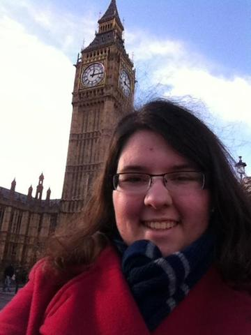 Ms. Butler wearing her Ravenclaw scarf in front of Big Ben in London, England in December 2013