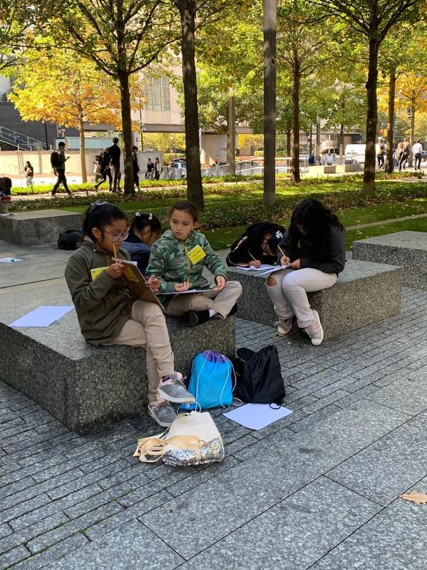 several girls sitting and taking notes