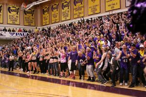 College of Idaho basketball crowd shot of fans in yellow and purple