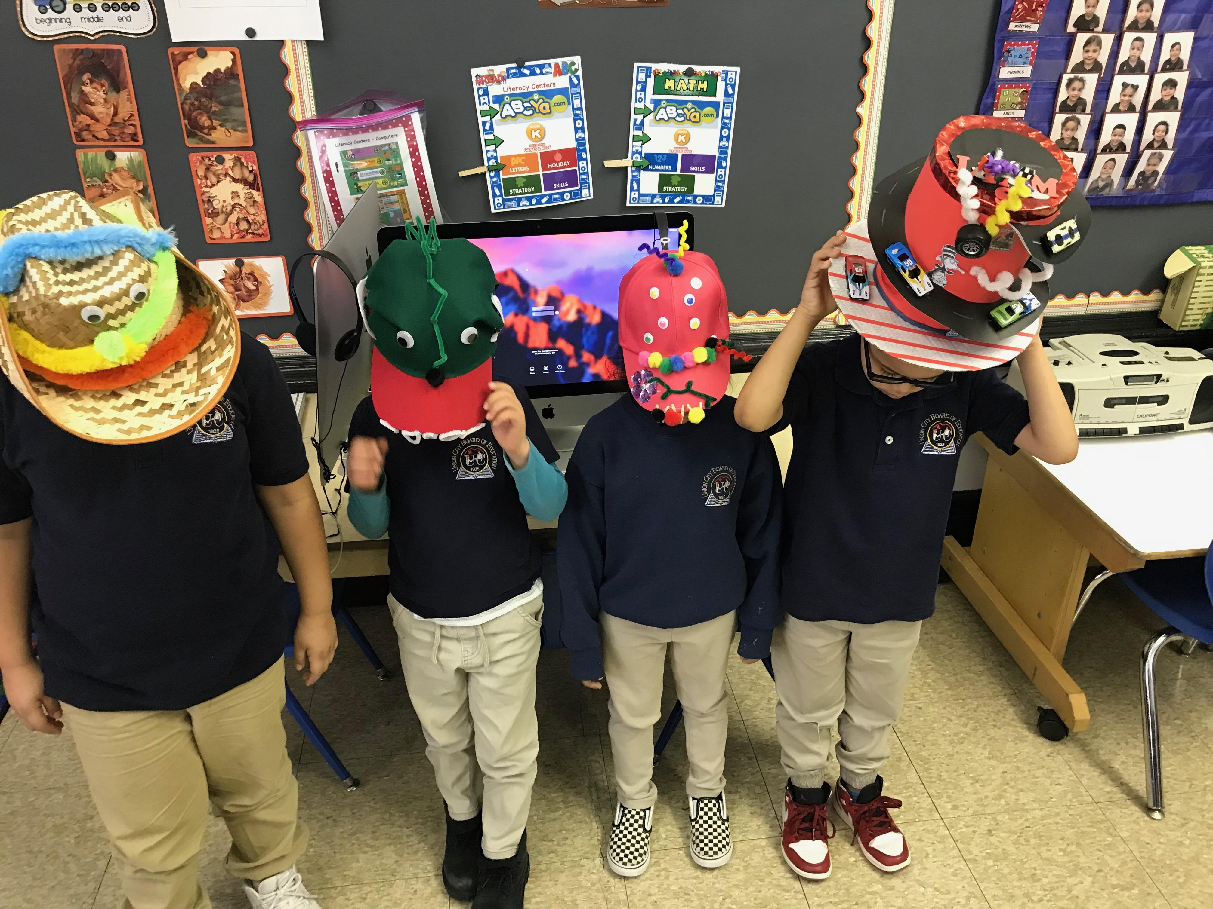 group of kids with their crazy hats