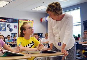 At teacher talks with a student.