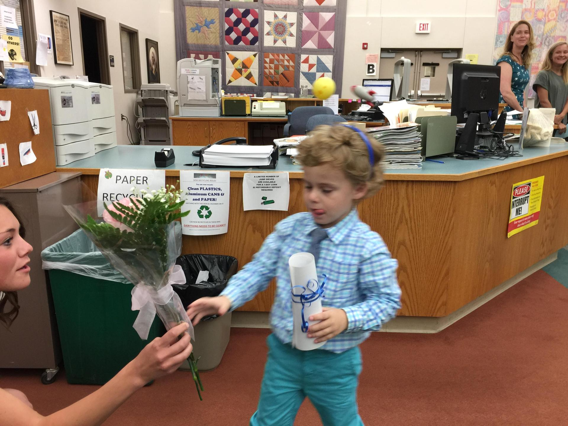 Student greets teacher at the end of year graduation for PlaySchool.