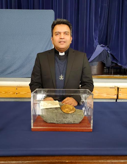 Father Jomon Brings a Saint's Relic to OP Featured Photo